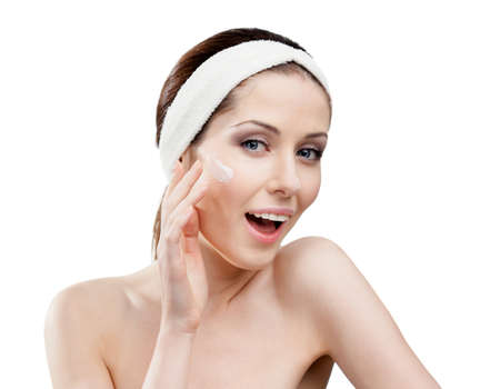 Woman with headband making face smoothing procedures, isolated on white Stock Photo - 16040418