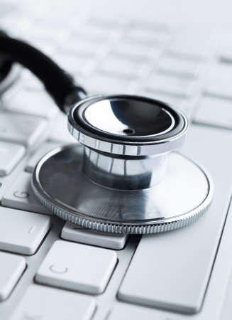 Close up of stethoscope on laptop keyboard. Health concept photo