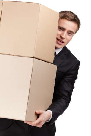 carries: Manager holding pile of cardboard boxes, isolated on white