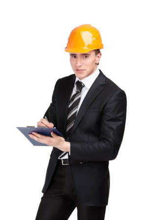 architecting: Making notes man in orange headpiece and suit, isolated on white