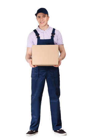 Workman in overalls and blue peaked cap keeps a cardboard box, isolated on white. Transportation service Stock Photo - 16040417