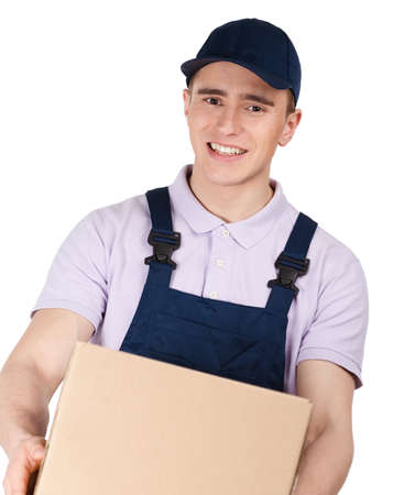 porter: Workman in overalls and blue peaked cap keeps a parcel, isolated on white. Transportation service