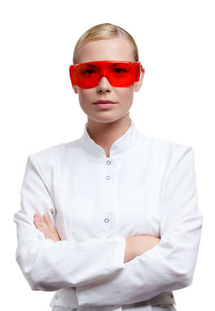 Female lab assistant is in red medical spectacles, isolated on white Stock Photo - 16041207