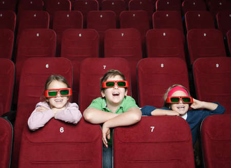 Laughing kids watching a movie photo