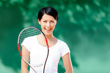 Portrait of professional female tennis player with racquet at the tennis court Stock Photo - 16041194