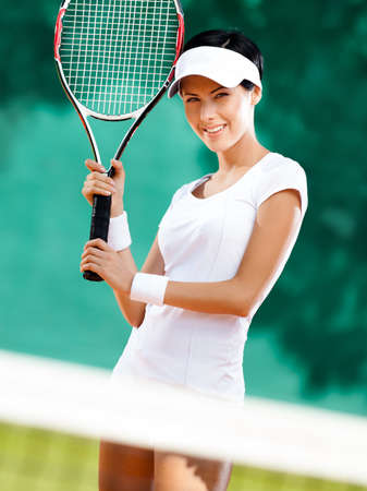 Sportswoman with racket at the tennis court. Healthy lifestyle Stock Photo - 16040631