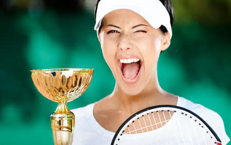 Tennis player won the cup at the sport tournament. Victory photo