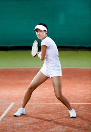 Tennis tournament. Female player at the clay tennis court photo