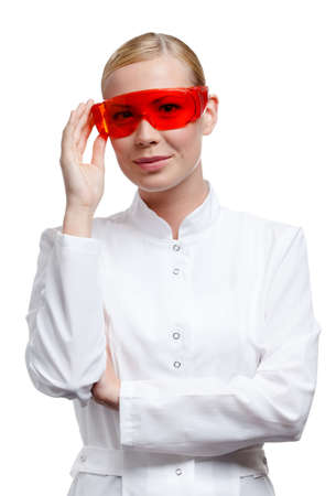 Lady doctor is in red medical spectacles, isolated on white Stock Photo - 16243844
