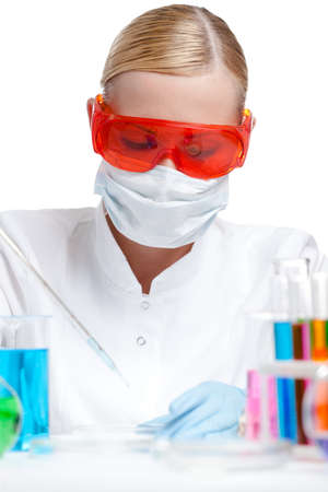 Young female lab assistant does some tests, chemistry concept, isolated on white photo