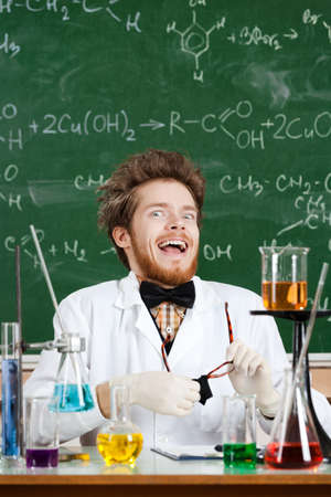 madly: Scientist laughs madly in his laboratory