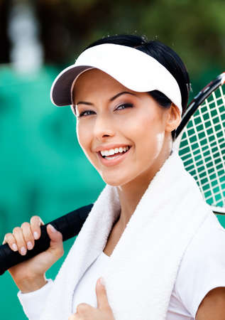 Professional female tennis player with towel on her shoulders. Active pastime Stock Photo - 16240932