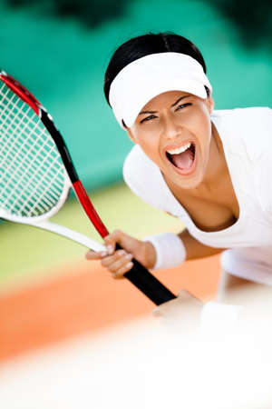 Woman in sportswear playing tennis. Contest Stock Photo - 16244284