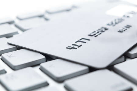 Close up of credit card on a pc keyboard. Concept of internet shopping photo