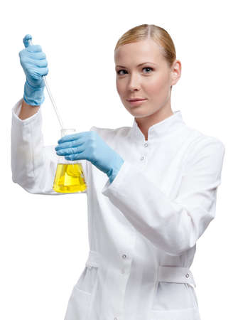 Chemist adds something to the liquid in the flask, isolated on white Stock Photo - 16440808