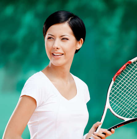 Portrait of professional female tennis player with racket at the tennis court Stock Photo - 16440751
