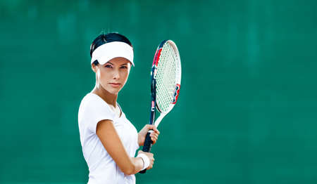 Woman in sportswear plays tennis at match Stock Photo - 16440722