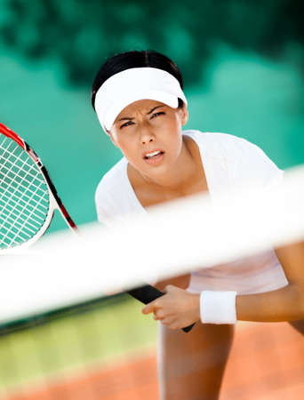 Woman in sportswear playing tennis. Leisure photo