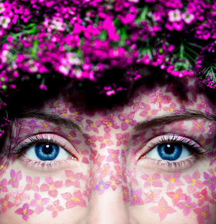 Close up of model's eyes with fashionable flowered make up photo