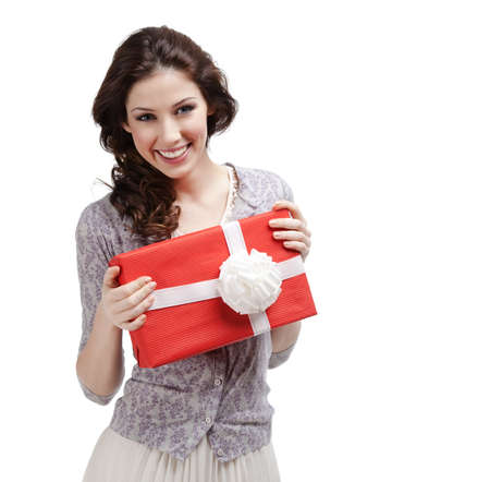 Young woman hands a present wrapped in red paper with white bow, isolated on white Stock Photo - 17457771