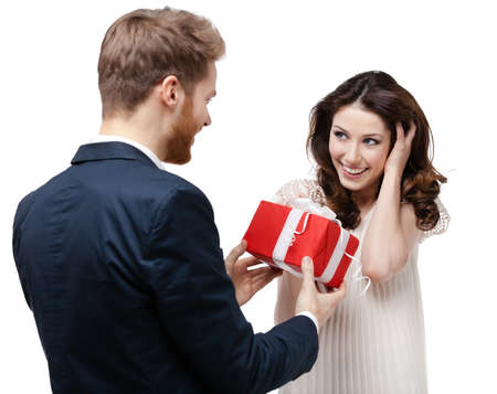 gladly: Man makes present to his lovely sweetheart, isolated on white