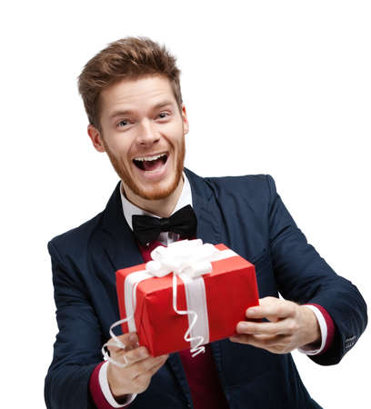 Funny man passes a gift wrapped in red packaging, isolated on white Stock Photo - 17457727