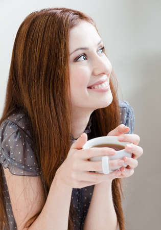 Smiley woman with cup of tea at the cafe Stock Photo - 17480586