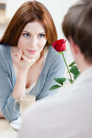 adult intercourse: Woman at the cafe with scarlet rose and her boyfriend