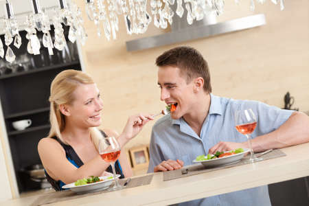 Husband and wife have romantic dinner in the kitchen Stock Photo - 17480624