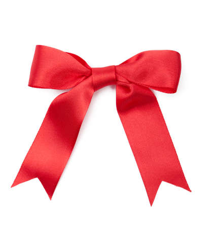 Scarlet satin gift bow, isolated on white. Symbol of party and happy holiday photo