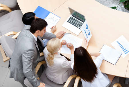Business people at the meeting discuss current issues at the modern office building. Successful work Stock Photo - 17457902