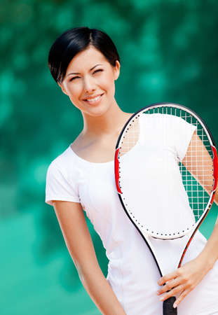 Portrait of professional tennis player with racket at the tennis court Stock Photo - 17479560