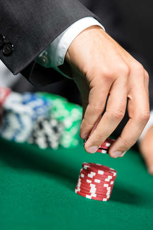 casino chips: Gambler stakes the pile of chips. Challenge to the casino