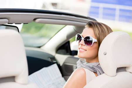 Girl checks the way with the help of the highway map sitting in the car Stock Photo - 17457898