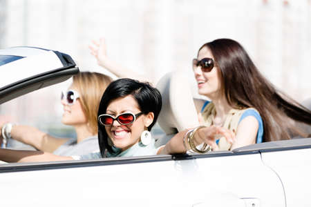 Group of happy girls in the white car. Little trip of teenage ladies Stock Photo - 17457404