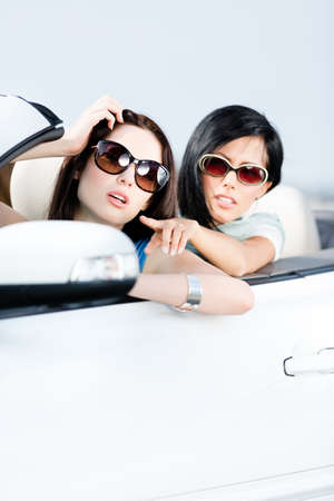 Girl showing something out of the auto to her driving friend Stock Photo - 17457849