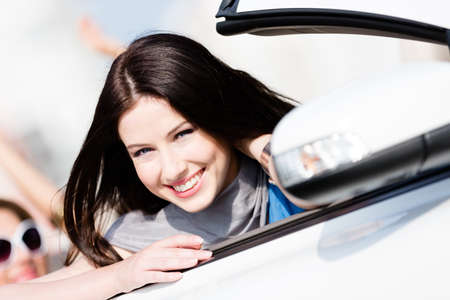 Close up of smiley woman in the automobile Stock Photo - 17480579