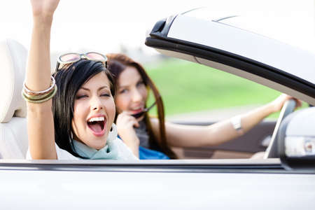 Two happy friends in the white car driving everywhere and looking for freedom and fun Stock Photo - 17457883