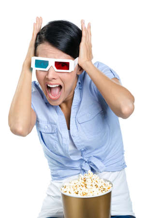 popcorn bowls: Putting hands on the head girl watching 3D movie, isolated on white