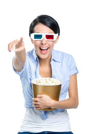 Viewer watching 3D cinema in spectacles with bowl full of popcorn, isolated on white photo