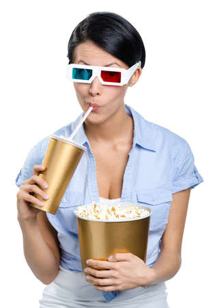 watching movie: Girl in 3D glasses drinking beverage with popcorn and watching film, isolated on white