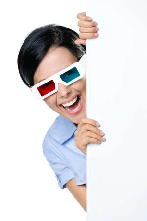 Spectator in 3D glasses peeps out from behind the copyspace, isolated on white photo