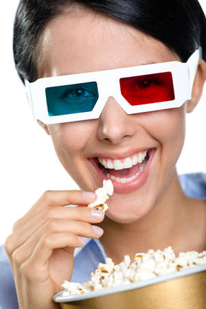 Headshot of the girl in 3D glasses eating popcorn and watching the film, isolated on white photo