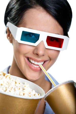 Viewer in 3D spectacles drinking beverage and eating popcorn, isolated on white photo