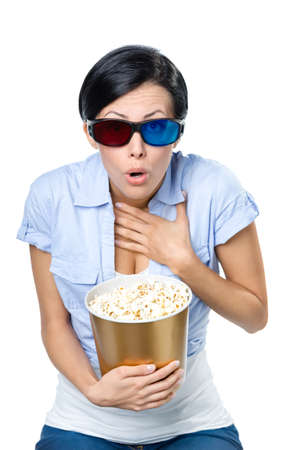 Girl in 3D glasses watching cinema with the bowl full of popcorn, isolated on white photo