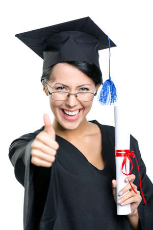 Graduating student with the certificate and in the black academic gown thumbs up, isolated on white photo