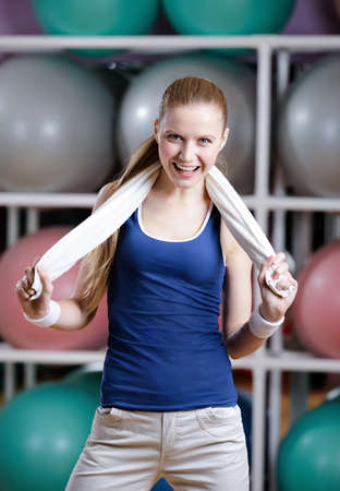Portrait of a sporty young woman in sportswear with white towel has a rest after fitness Stock Photo - 17457773