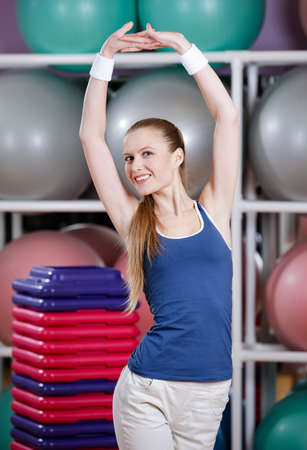 Athletic woman in sportswear stretching herself in gym class Stock Photo - 17457810