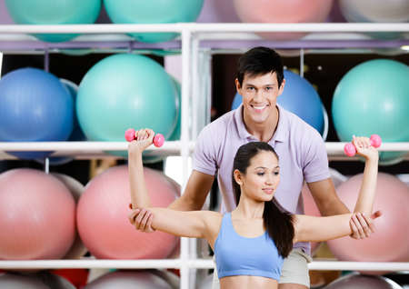 Sportive girl exercises in fitness gym with couch Stock Photo - 17457731