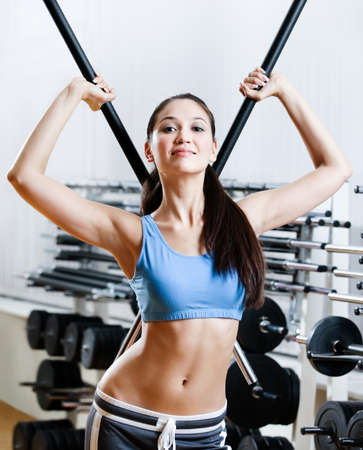 Woman with dumbbells stick in sport centre Stock Photo - 17457745